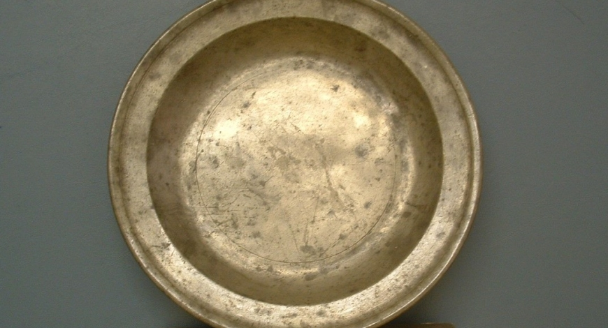 What is the Story Behind the Pewter Plate?
