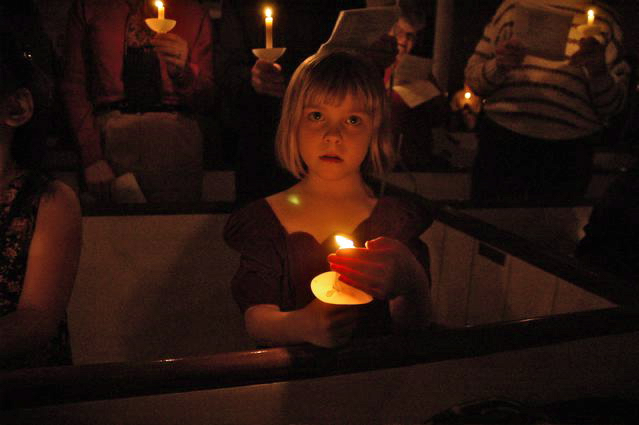 Girl with Christmas candle